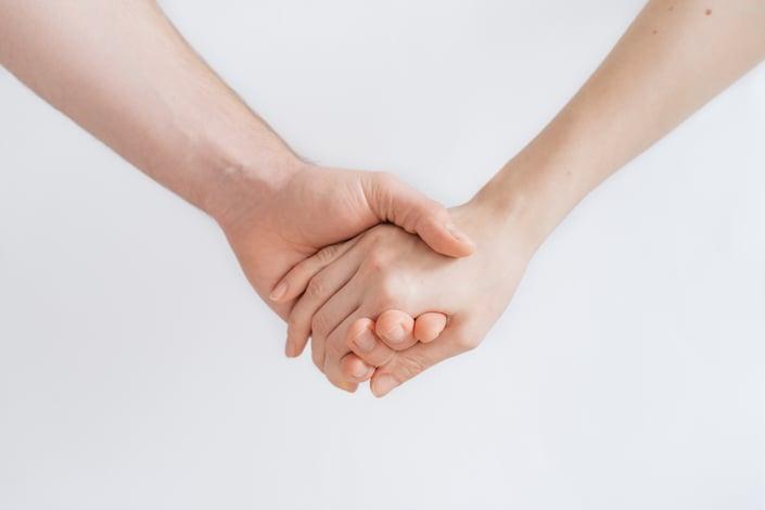 Women compulsive gambling. Hand holding.